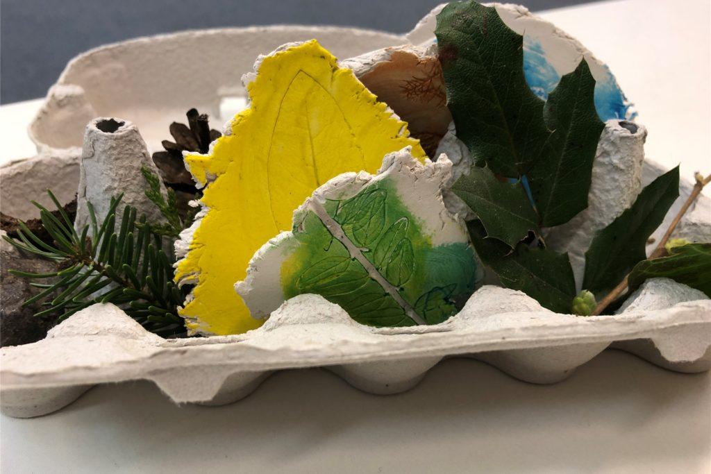 Ein Eierkarton mit Blättern und Zweigen - gebastelt für die Präsentation in der Seestadthalle - steht als Symbol für das Konzept der neuen Bossendorfer Kita: Urbane Naturpädagogik soll die Kinder mit Flora und Fauna bestens vertraut machen.