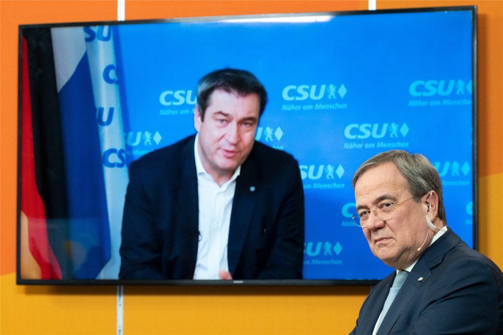 Sind die Favoriten auf den Posten des Kanzlerkandidaten der Union: Markus Söder (l.) und Armin Laschet.