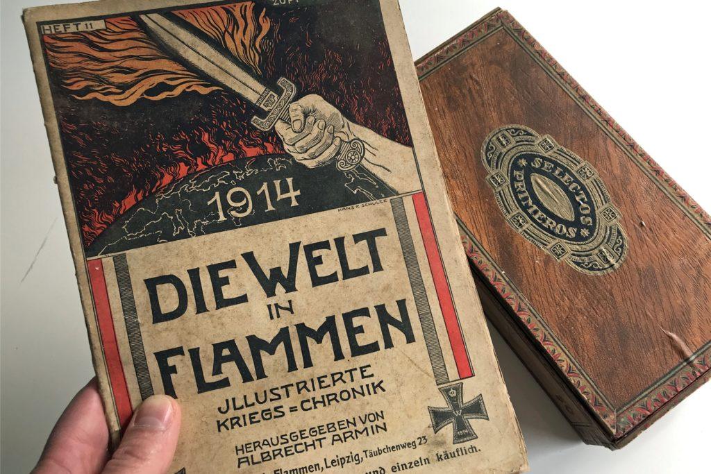 Ein Heft aus dem ersten Weltkrieg und mehrere solcher Zigarrenschachteln voller Bilder und Dokumente hat Theo Elberfelds verstorbener Cousin Heinz verwahrt.